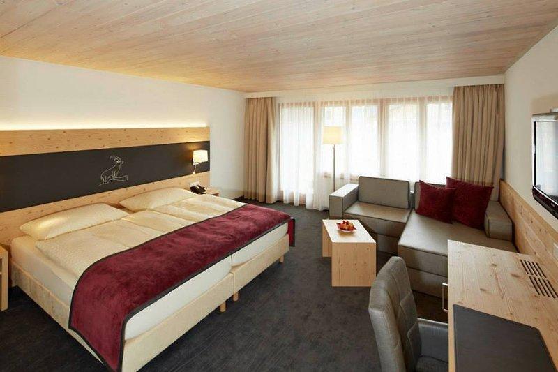 Hotelzimmer mit Tischtennis im Laaxerhof