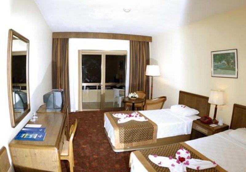 Hotelzimmer mit Mountainbike im Özkaymak Incekum Hotel