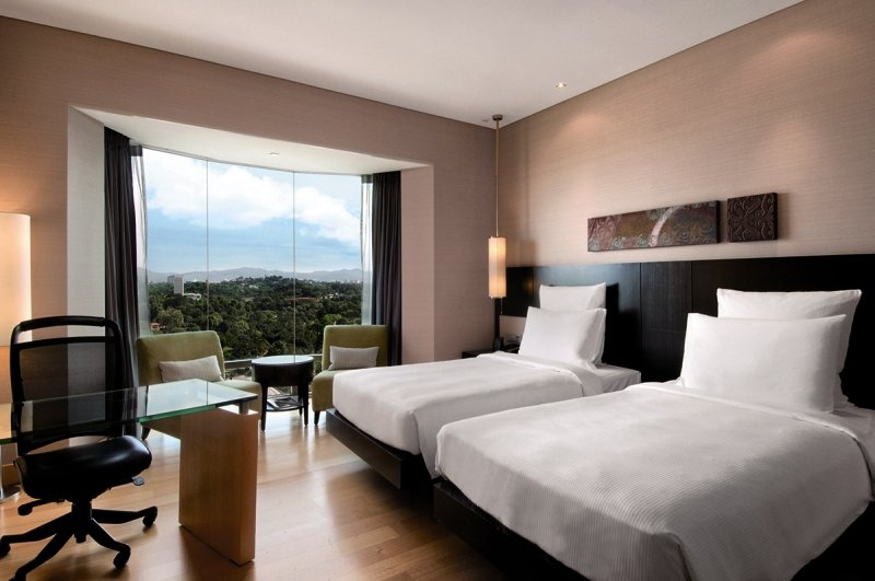 Hotelzimmer mit Fitness im Hilton Kuala Lumpur