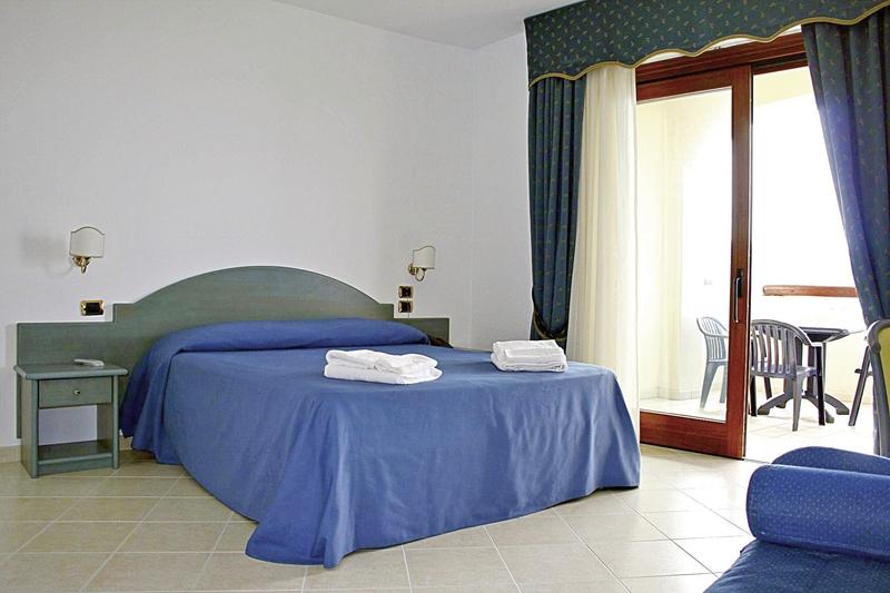 Hotelzimmer mit Mountainbike im Hotel Scoglio del Leone