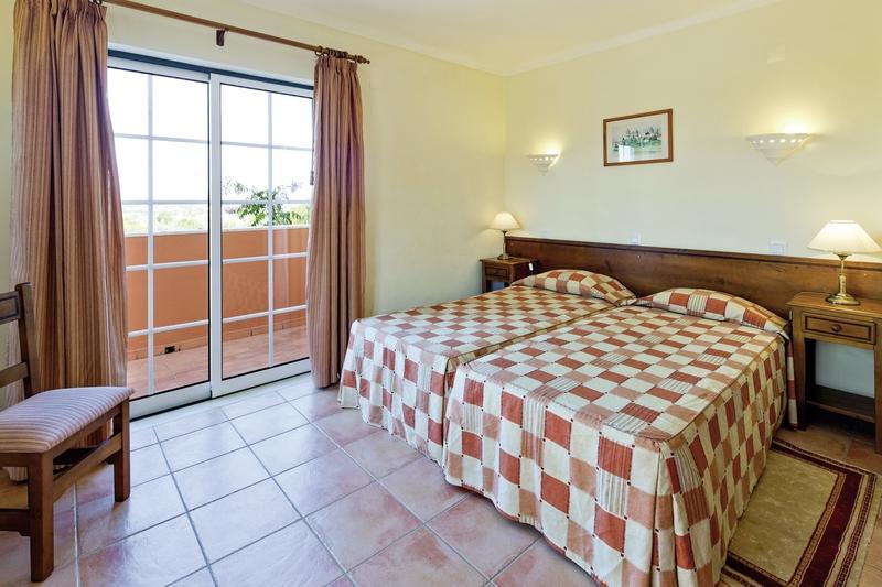 Hotelzimmer mit Mountainbike im Colina da Lapa