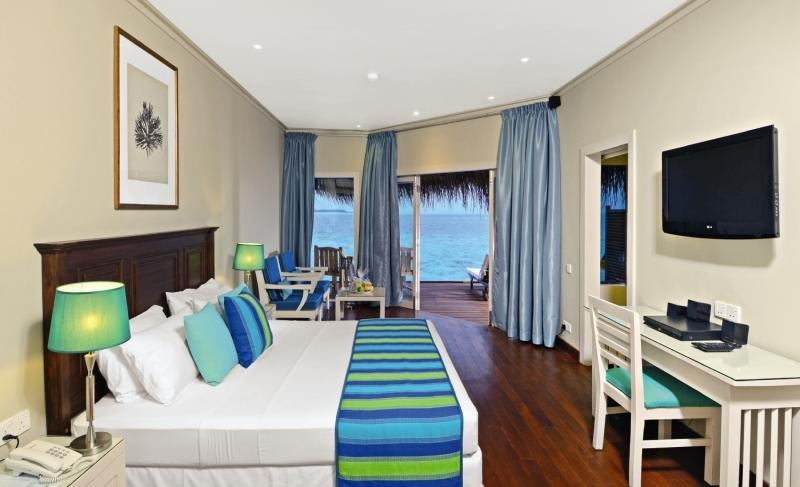 Hotelzimmer mit Tischtennis im Adaaran Club Rannalhi