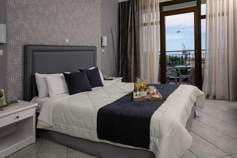 Hotelzimmer mit Mountainbike im Alia Palace Luxury Hotel & Villas