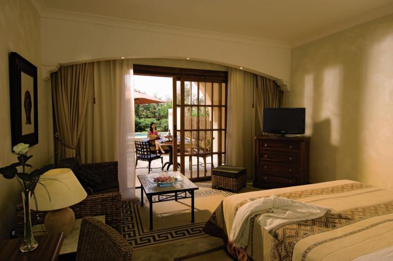 Hotelzimmer mit Mountainbike im Elysium