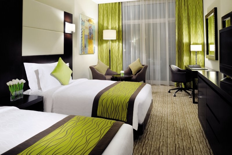 Hotelzimmer mit Fitness im Mövenpick Hotel Jumeirah Lakes Towers