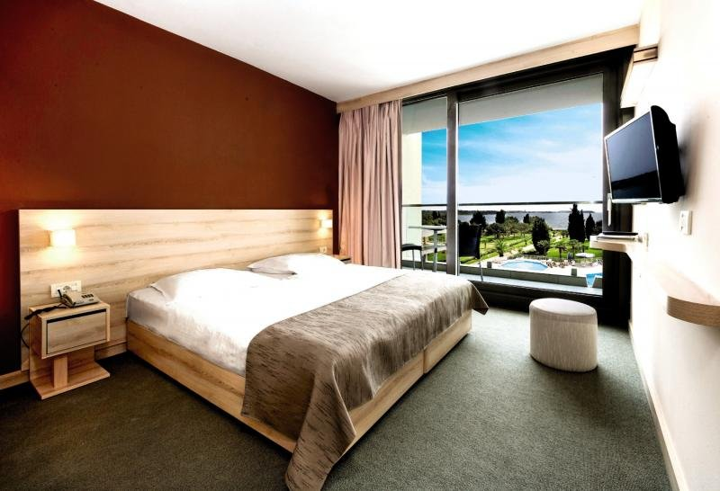 Hotelzimmer mit Mountainbike im Hotel Materada Plava Laguna