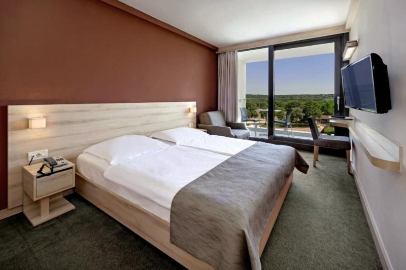 Hotelzimmer mit Minigolf im Hotel Materada Plava Laguna