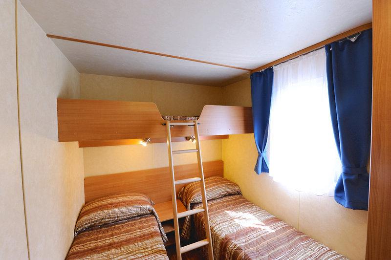 Hotelzimmer mit Mountainbike im Europa Villaggio