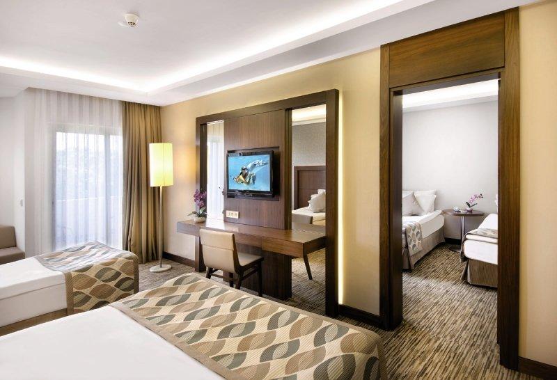 Hotelzimmer mit Yoga im Belconti Resort